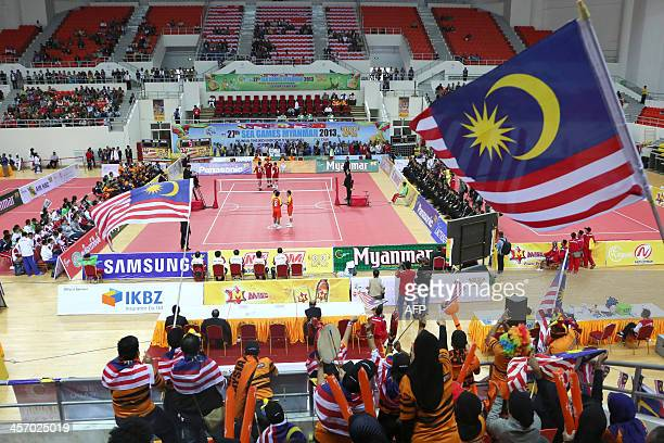 Supporters of Malaysia are seen attending their team's match against Thailand during the sepaktakraw competition men's regu final at the 27th SEA...