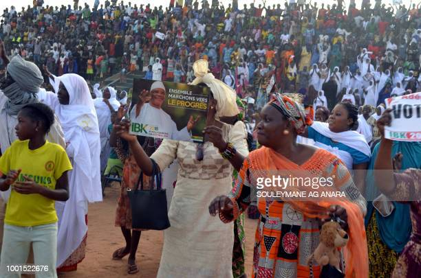 Supporters of Malian incumbent president Ibrahim Boubacar Keita gather at the Gao stadium on July 18 2018 for a presidential campaign rally