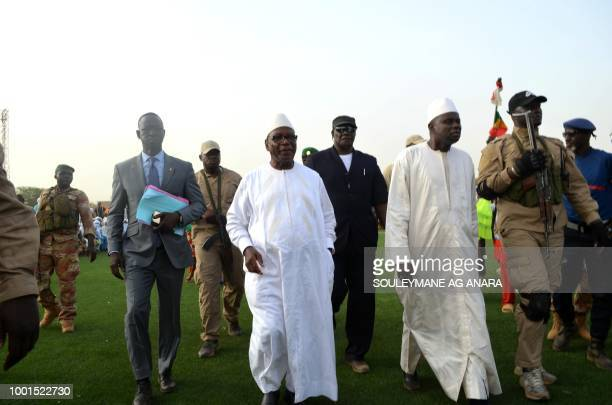 Supporters of Malian incumbent president Ibrahim Boubacar Keita arrives at the Gao stadium on July 18 2018 for a presidential campaign rally