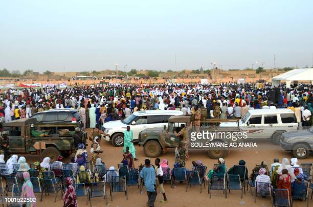 Supporters of Malian incumbent president Ibrahim Boubacar Keita motorcade arrives at the Gao stadium on July 18 2018 for a presidential campaign rally