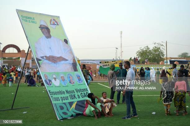 Supporters of Malian incumbent president Ibrahim Boubacar Keita wait at the Gao stadium on July 18 2018 for a presidential campaign rally