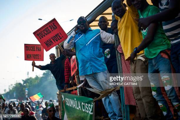 Supporters of Malian oppositon leader Soumaila Cisse take part in a rally to protest the results of a presidential runoff vote on August 16 in...