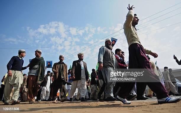 Supporters of Malik Mumtaz Qadri the self confessed killer of Punjab governor Salman Taseer shout slogans outside the Adiyala prison in the garrison...