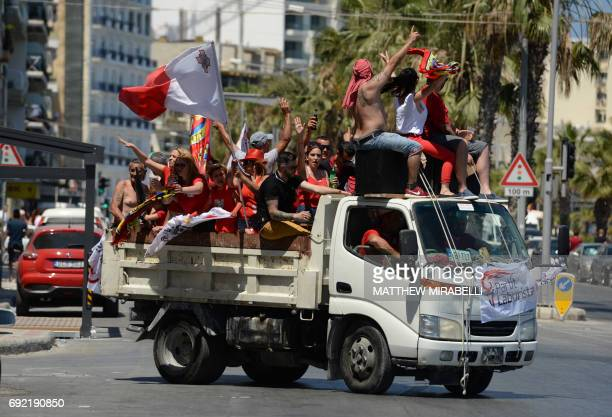 Supporters of Malta's Labour Party celebrate after winning the general election leading to the reelection of outgoing Prime Minister Joseph Muscat on...