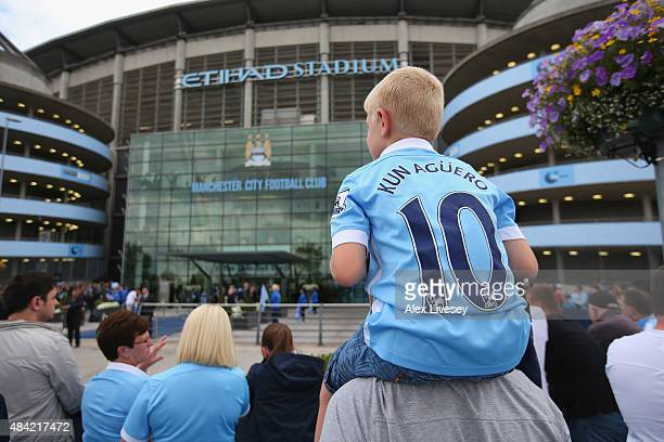 Supporters of Manchester City wait for the teams to arrive prior to the Barclays Premier League match between Manchester City and Chelsea at Etihad...