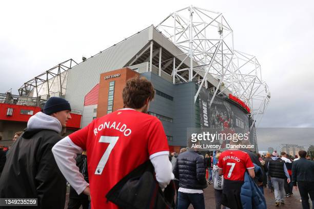 Supporters of Manchester United arrive at Old Trafford ahead of the Premier League match between Manchester United and Liverpool at Old Trafford on...