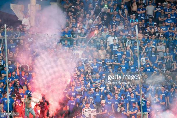 Supporters of Mannheim light fireworks during the Third League Playoff Leg 2 match between SV Waldhof Mannheim and KFC Uerdingen at CarlBenzStadium...