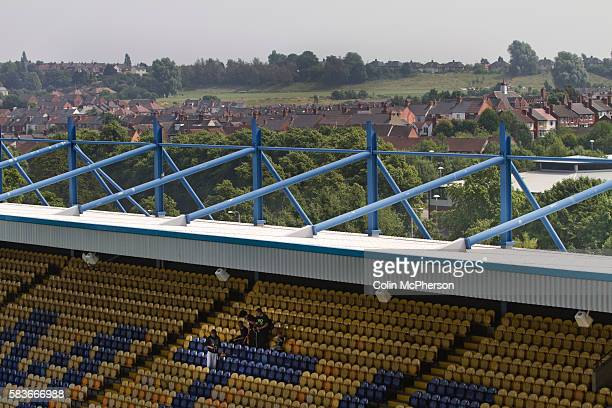 Supporters of Mansfield Town sitting in one of the stands at Field Mill stadium during an open day held for the club's supporters Mansfield Town...