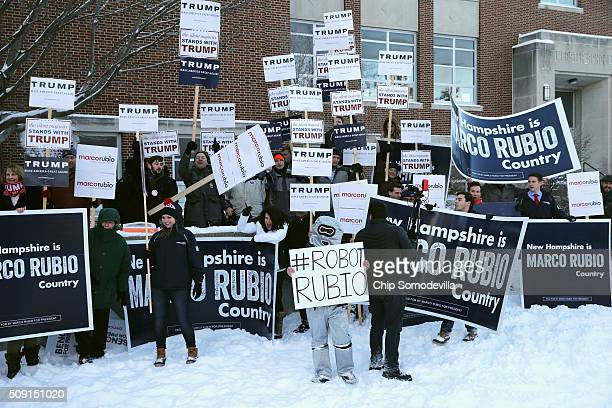 Supporters of many of the presidential candidates hold campaign signs and shout slogans outside the polling place at Webster School before the...