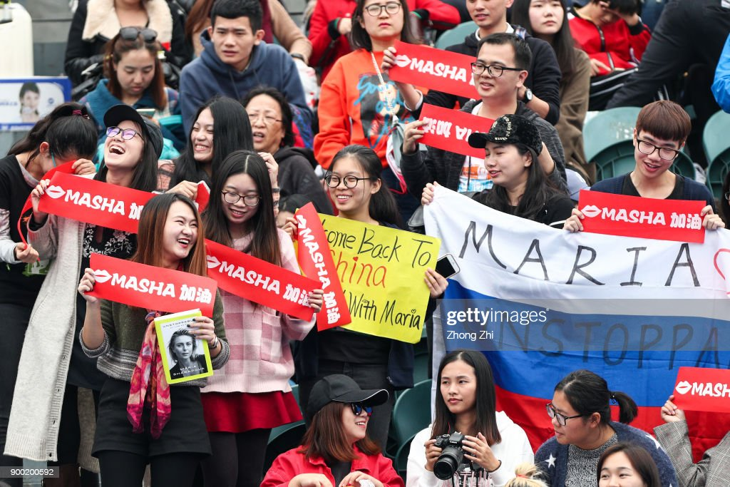 Supporters of Maria Sharapova of Russia cheer during the match against Mihaela Buzarnescu of Romania during Day 2 of 2018 WTA Shenzhen Open at Longgang International Tennis Center on January 1, 2018 in Shenzhen, China.