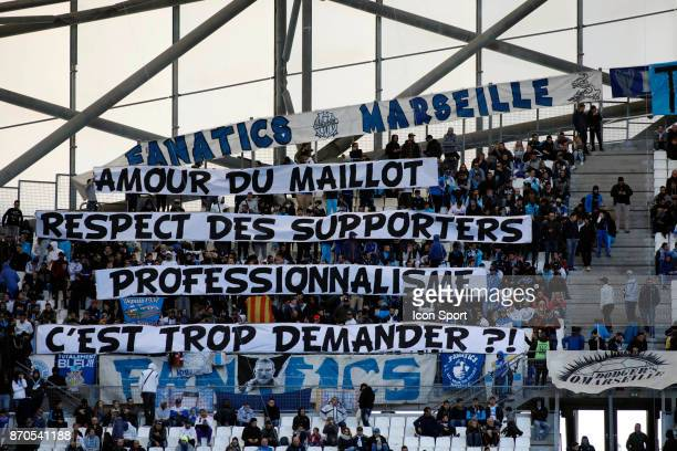 supporters of Marseille with a banner against Patrice Evra during the Ligue 1 match between Olympique Marseille and SM Caen at Stade Velodrome on...