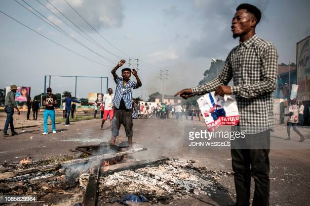 Supporters of Martin Fayulu the runner up in the Democratic Republic of the Congo's elections protest in the street on January 21 2019 in Kinshasa...