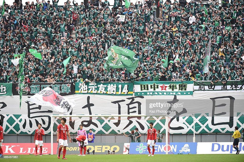 Supporters of Matsumoto Yamaga excited with 3rd goal of Kohei Kiyama of Matsumoto Yamaga during the J. League match between Nagoya Grampus and Matsumoto Yamaga at Toyota Stadium on March 7, 2015 in Toyota, Japan.