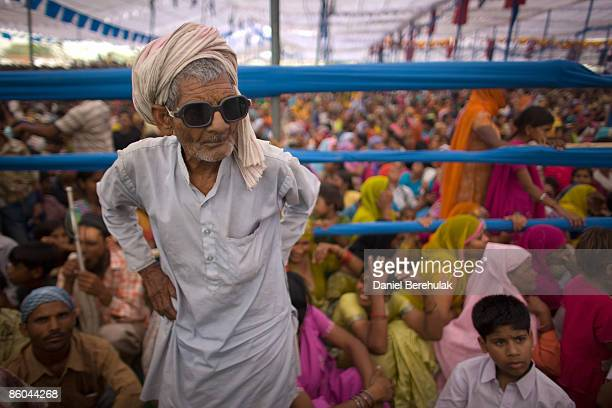 Supporters of Mayawati Kumari, Bahujan Samaj Party President and Chief Minister of Uttar Pradesh state, listen to her speech during a political rally...