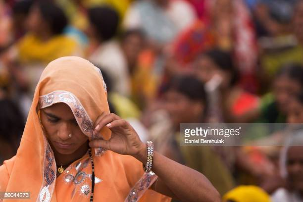 Supporters of Mayawati Kumari, Bahujan Samaj Party President and Chief Minister of Uttar Pradesh state, wait during a political rally on April 6,...