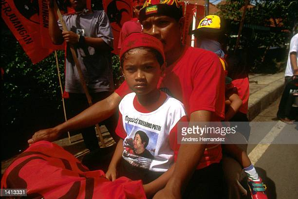 Supporters of Megawati Sukanoputri attend the rally to kick off the campaign of Indonesian presidential candidate Amien Rais May 16 1999 in Jakarta...