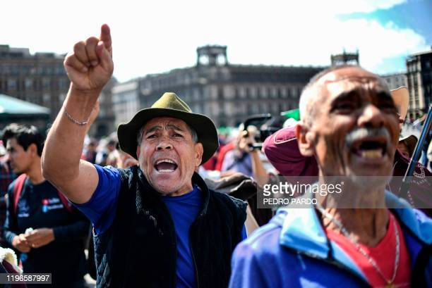 Supporters of Mexican President Andres Manuel Lopez Obrador shout slogans at people participating in a march for peace in Mexico City on January 26...