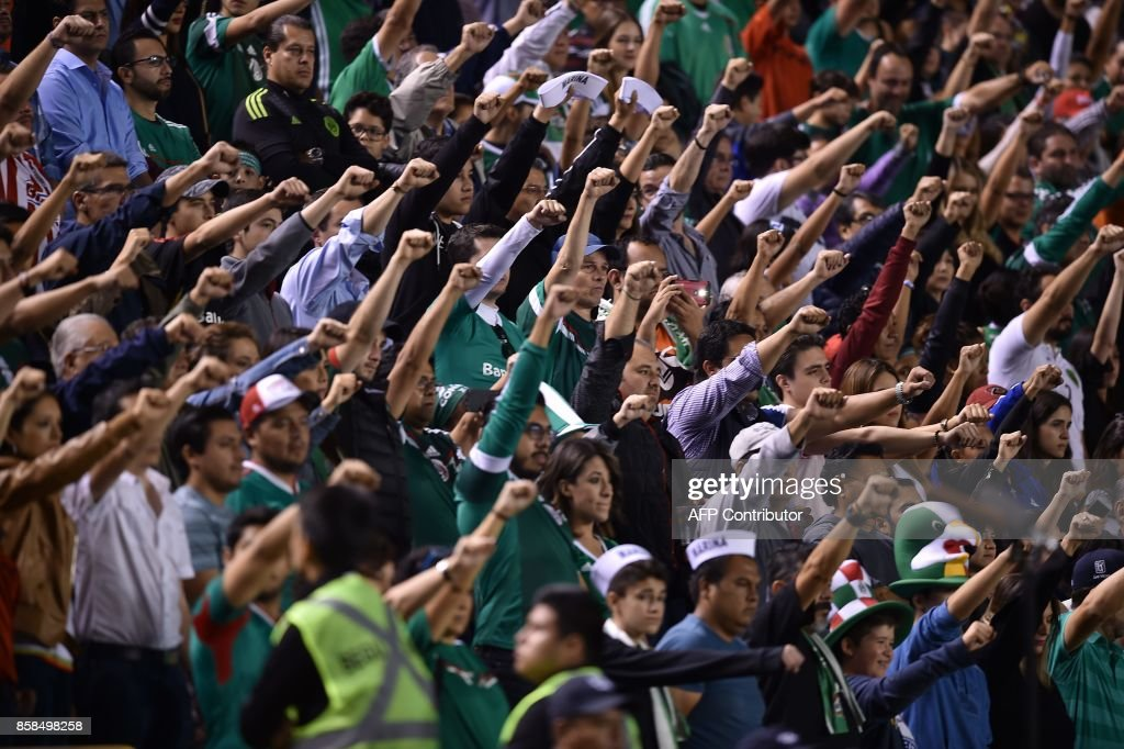 Supporters of Mexico pay tribute to the victims of the last earthquake during their World Cup 2018 qualifier football match against Trinidad & Tobago at the Alfonso Lastras stadium in San Luis Potosi, Mexico, on October 6, 2017. /