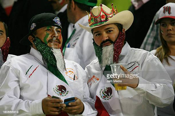 Supporters of Mexico watch a match between Mexico and Puerto Rico for the Caribbean Series 2013 on February 6 2013 in Hermosillo Mexico