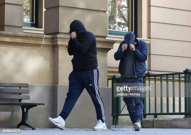 Supporters of Michael and Fadi Ibrahim, Mustapha Dib and Koder Jomaa have a cigarette break and hide their faces from the media at Sydney Central...