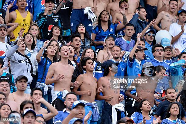 Supporters of Millonarios cheer for their team during a second leg match between Millonarios and Junior as part of quarter finals of Liga Aguila I...