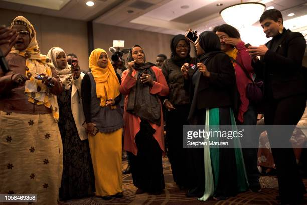 Supporters of Minnesota Democratic Congressional Candidate Ilhan Omar celebrate at an election night party on November 6 2018 in Minneapolis...