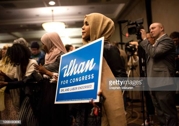 Supporters of Minnesota Democratic Congressionalelect Ilhan Omar holds a sign at an election night results party on November 6 2018 in Minneapolis...