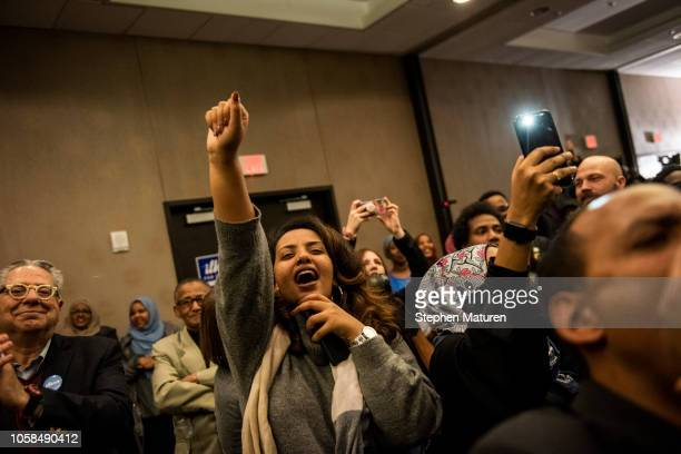 Supporters of Minnesota Democratic Congressionalelect Ilhan Omar cheer at an election night results party on November 6 2018 in Minneapolis Minnesota...