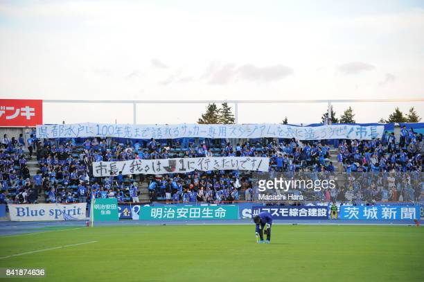 Supporters of Mito Hollyhock hold messages prior to the JLeague J2 match between Mito Hollyhock and Nagoya Grampus at K's Denki Stadium on September...