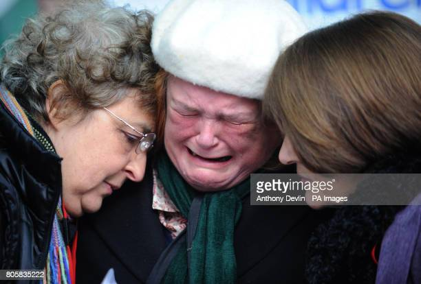 Supporters of MMR research doctor Andrew Wakefield show emotion before he makes a statement at the General Medical Council headquarters in London