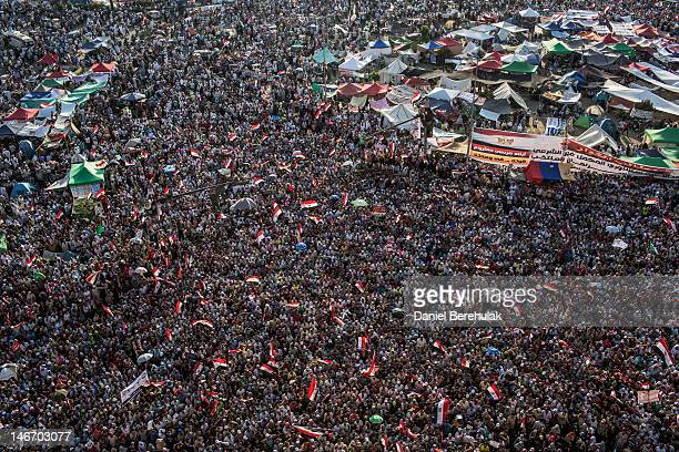 Supporters of Mohamed Morsi the Muslim Brotherhood's candidate protest against Egypt's military rulers in Tahrir Square on June 22 2012 in Cairo...