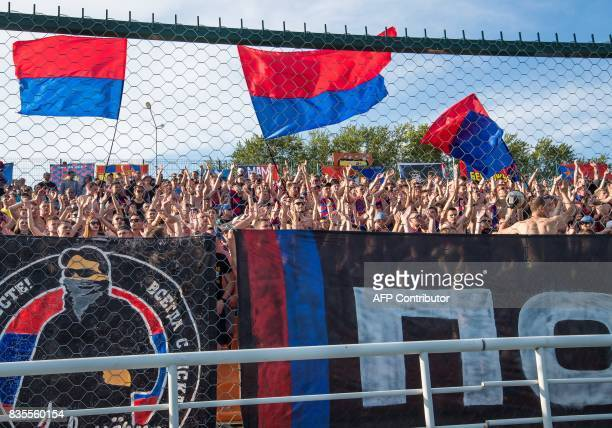 Supporters of Moscow's CSKA shout slogans during the Russian Premier League match CSKA Moscow vs FC Ural Yekaterinburg at the SKBBank Arena in...
