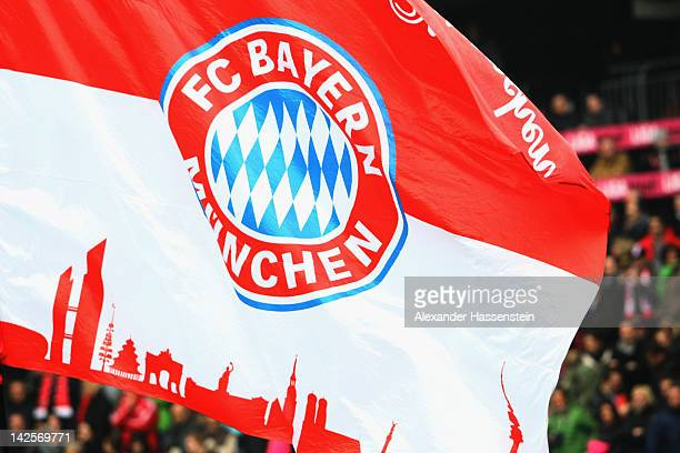 Supporters of Muenchen wave flags during the Bundesliga match between FC Bayern Muenchen and FC Augsburg at Allianz Arena on April 7 2012 in Munich...