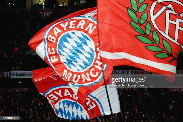 Supporters of Muenchen wave flags prior to the DFB Cup semi final match between FC Bayern Muenchen and Borussia Dortmund at Allianz Arena on April 26...