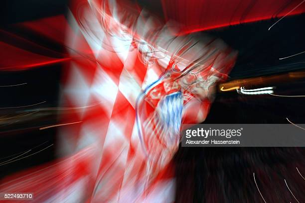 Supporters of Muenchen wave flags prior to the DFB Cup semi finale match between FC Bayern Muenchen and Werder at Allianz Arena on April 19 2016 in...