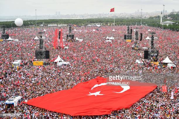 Supporters of Muharrem Ince presidential candidate of Turkey's main opposition Republican People's Party hold a giant Turkish flag during an election...