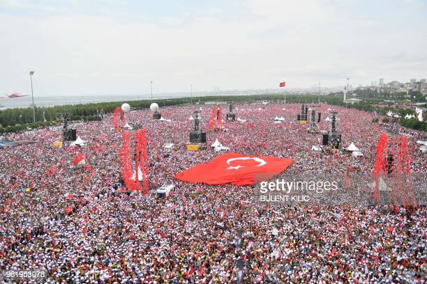 TOPSHOT Supporters of Muharrem Ince presidential candidate of Turkey's main opposition Republican People's Party hold a giant Turkish flag during an...