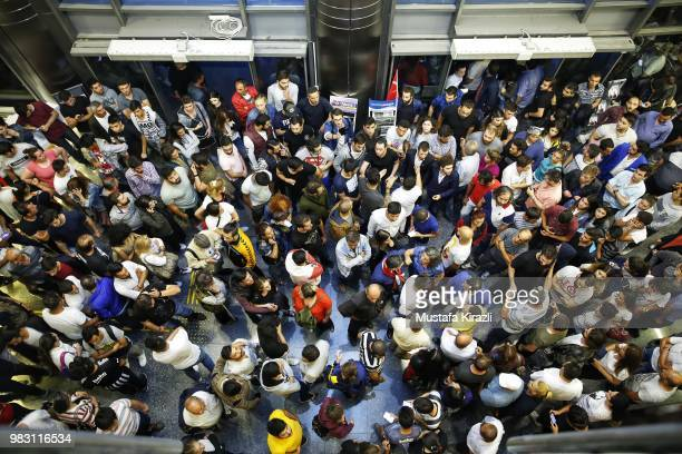 Supporters of Muharrem Ince wait dejectedly at Republican People's Party headquarters on June 24 2018 in Ankara Turkey Turkey's President Recep...