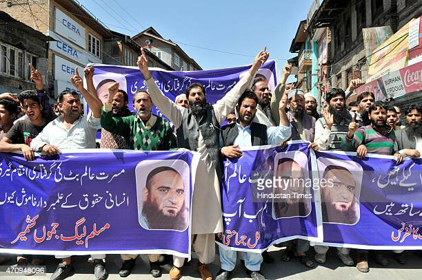 Supporters of Muslim League Chief Masarat Alam shouts slogans during a protest against the slapping of PSA against him on April 24 2015 in Srinagar...