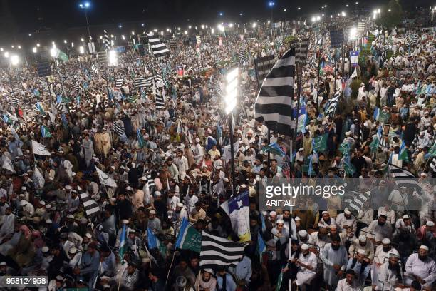 Supporters of Muttahida MajliseAmal a religious parties alliance waves flags during a public meeting in Lahore on May 13 in the connection of...