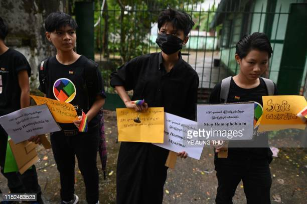 Supporters of Myanmar's LGBT community hold banners during a rally to protest the death of Kyaw Zin Win outside Myanmar Imperial University in Yangon...