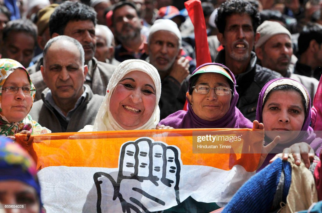 Supporters of National Conference and Congress listen to National Conference Patron and President Farooq Abdullah during an election rally after filling his nomination paper for parliamentary elections on March 20, 2017 in Srinagar, India.