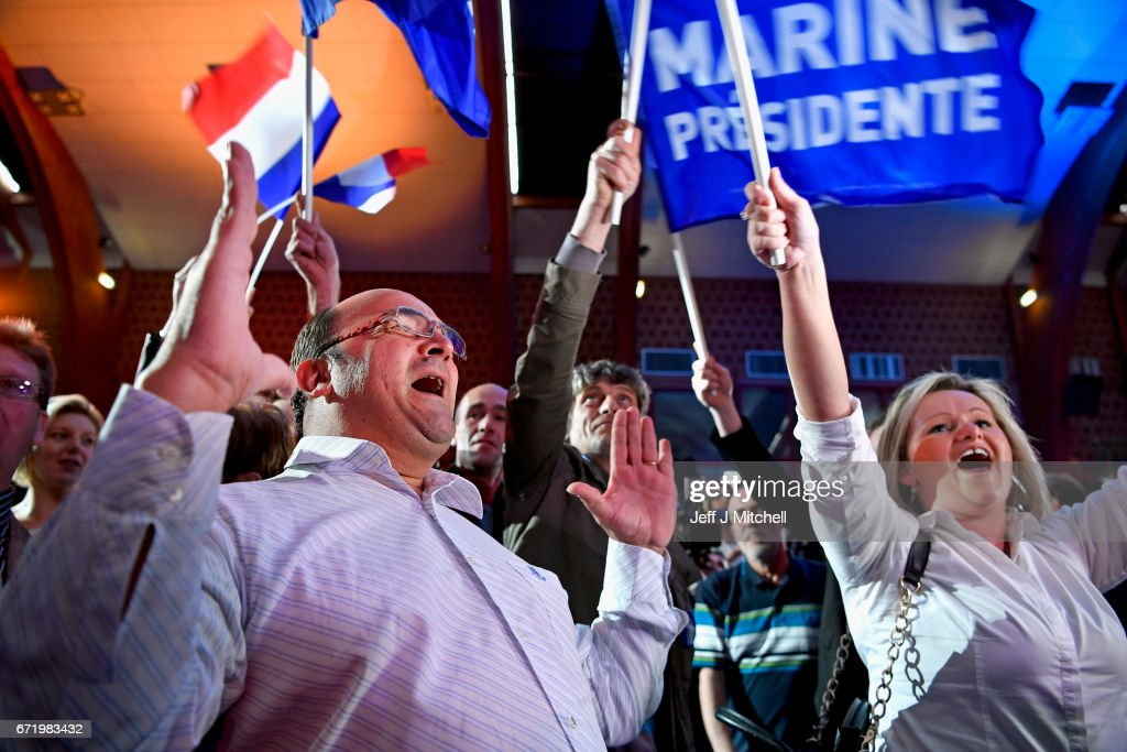 Supporters of National Front leader Marine Le Pen cheer in celebration in the Espace Francios Mitterrand on April 23, 2017 in Henin Beaumont, France. According to projected results, founder and leader of the political movement 'En Marche !' Emmanuel Macron has received the most votes with National Front Party leader Marine Le Pen in second place, meaning both will now compete against each other in the next round of the French Presidential Elections on May 7.