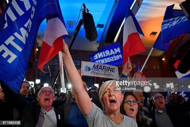 Supporters of National Front leader Marine Le Pen cheer in celebration in the Espace Francios Mitterrand on April 23, 2017 in Henin Beaumont, France....