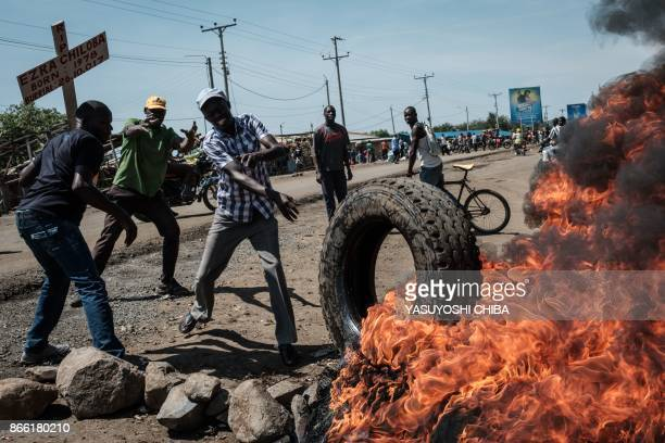 Supporters of National Super Alliance presidential candidate Raila Odinga burn tyres and barricade roads during a demonstration on the boycott of the...