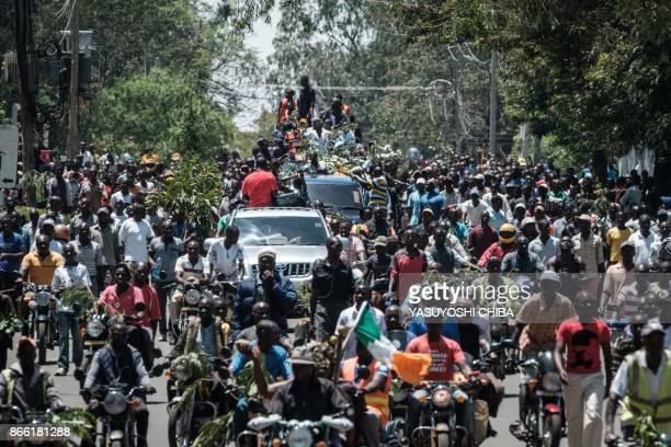 Supporters of National Super Alliance presidential candidate Raila Odinga chant October No election as they demonstrate in the streets on the boycott...