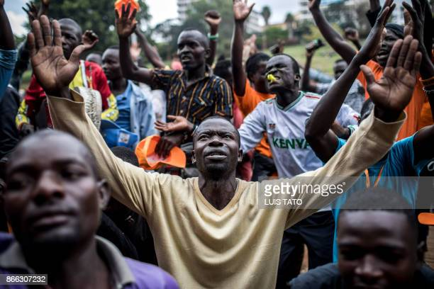 TOPSHOT Supporters of National Super Alliance presidential candidate Raila Odinga pray during a protest prior to a political rally in Kenya's capital...