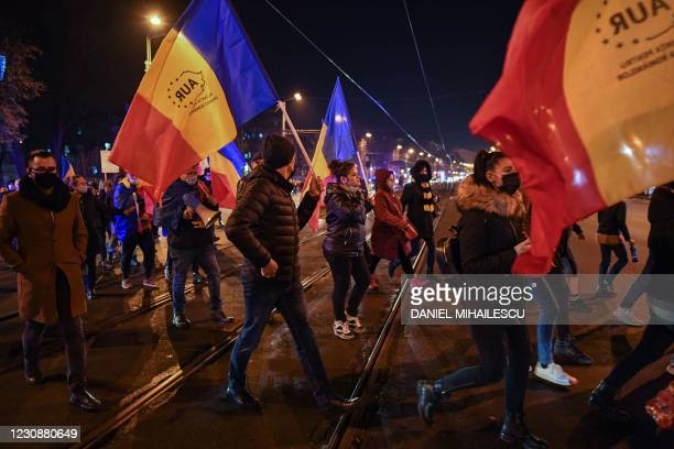 Supporters of nationalist parliamentary party AUR protest against the health ministry, in downtown Bucharest, on January 30, 2021. - Romania was in...
