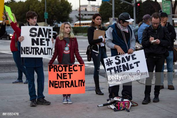 Supporters of net neutrality protest outside a Federal Building in Los Angeles California on November 28 2017 The activists gathered in protest of...