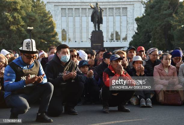 Supporters of newly appointed Prime Minister Sadyr Japarov pray during a rally in support of Japarov in Bishkek on October 14, 2020. - Kyrgyzstan's...